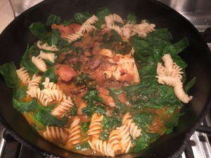 poached wild cod with mushrooms, onions, spinach and pasta