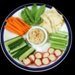 957946 - entertaining platter with a combination of healthy finger food.